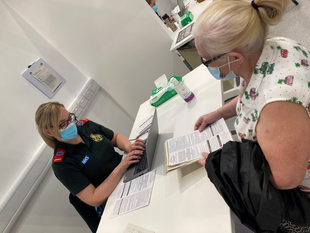 COVID-19 vaccination patient being assessed by a member of the North East Ambulance Service