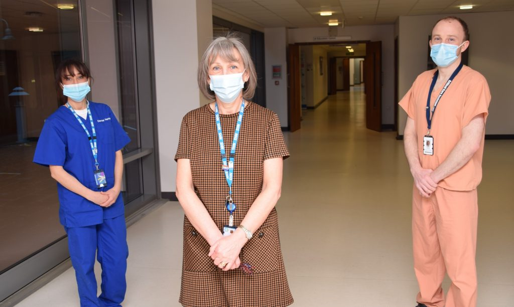 Susie Landreth (centre) with dental nurse daughter Michelle and critical care assistant son Stephen